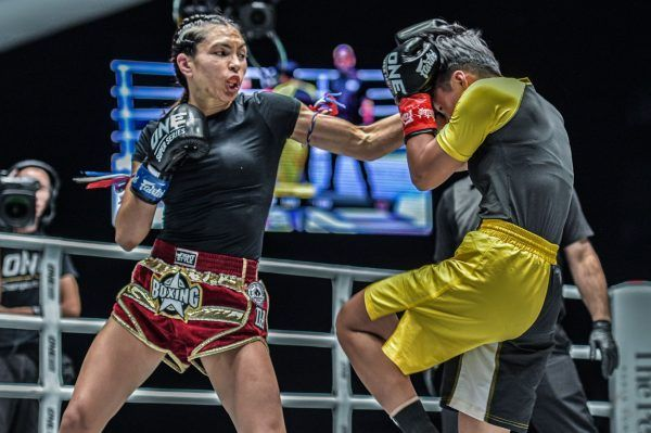 American kickboxer Janet Todd cracks former ONE Atomweight Kickboxing World Champion Chuang Kai Ting with a punch