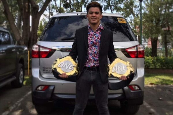 Jhanlo Sangiao poses with ONE Championship belts