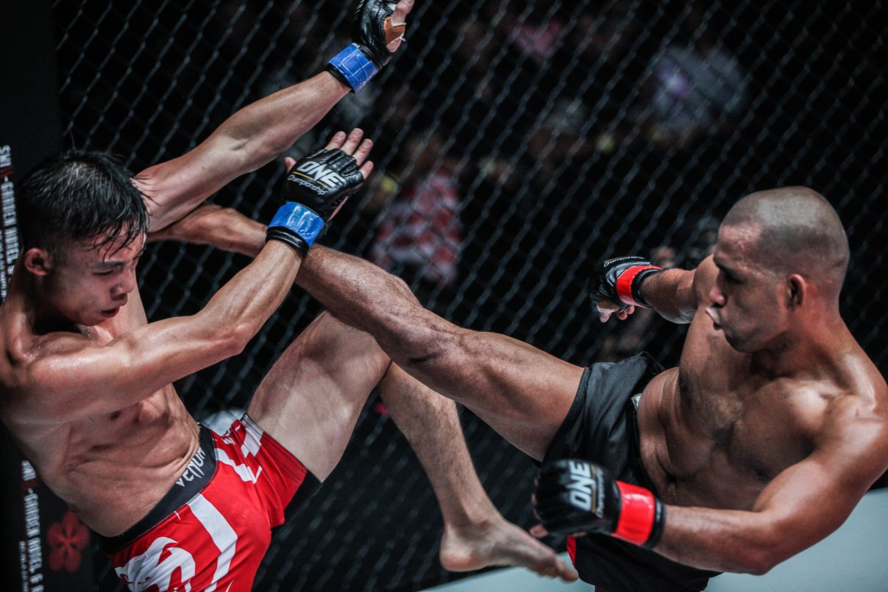 Philippine mixed martial artist Rene Catalan lands a roundhouse kick