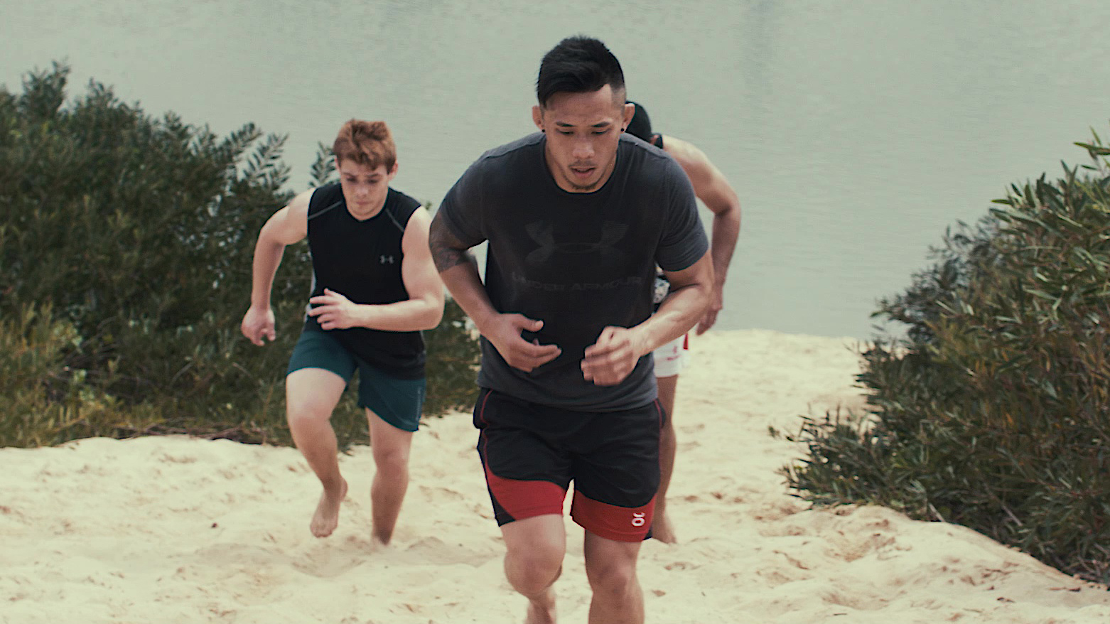 ONE Featherweight World Champion Martin Nguyen running with friends