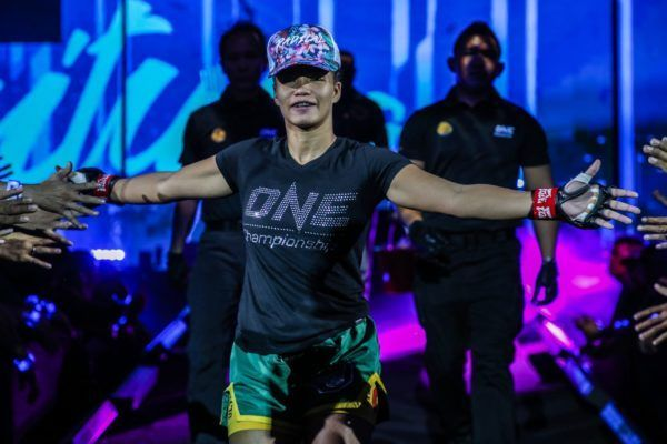 Former ONE Women's Strawweight World Title challenger Samara Santos walks to the ring inside the Mall Of Asia Arena