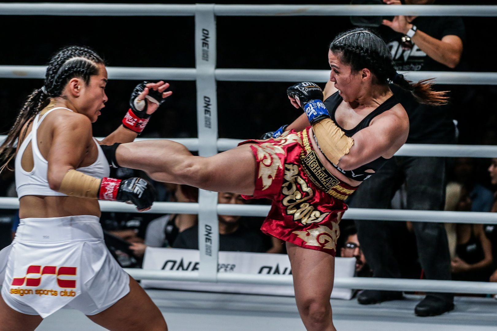 India's Puja Tomar finds an opening and kicks Vietnam's Bi Nguyen