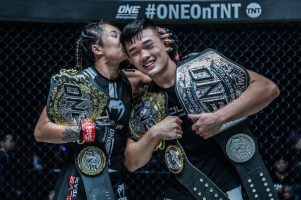 Angela Lee and Christian Lee with their ONE Championship belts at ONE: CENTURY