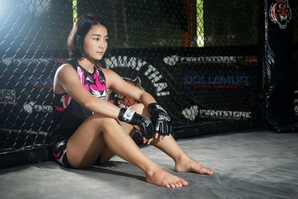 Rika Ishige sits in the cage