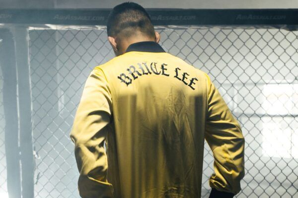 MMA fighter Martin Nguyen wears the Game Of Death pullover from the ONE X Bruce Lee Collection from ONE.SHOP!