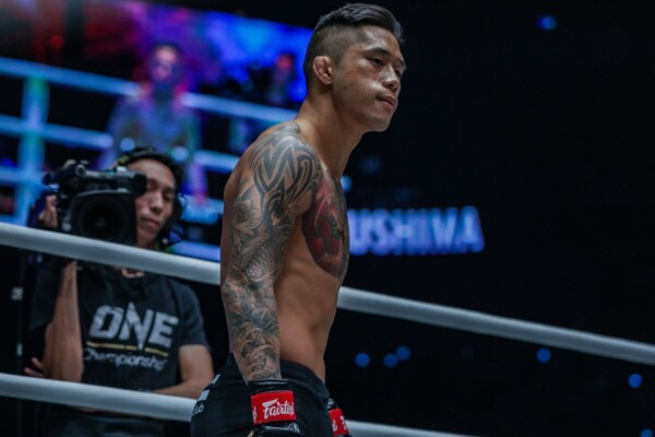 ONE Featherweight World Champion Martin Nguyen stands poised in the ring at ONE: DAWN OF HEROES.