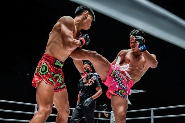Cambodia's Sok Thy throws a roundhouse at Huang Ding